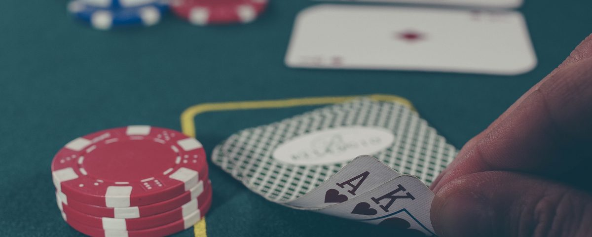poker hand at betting table